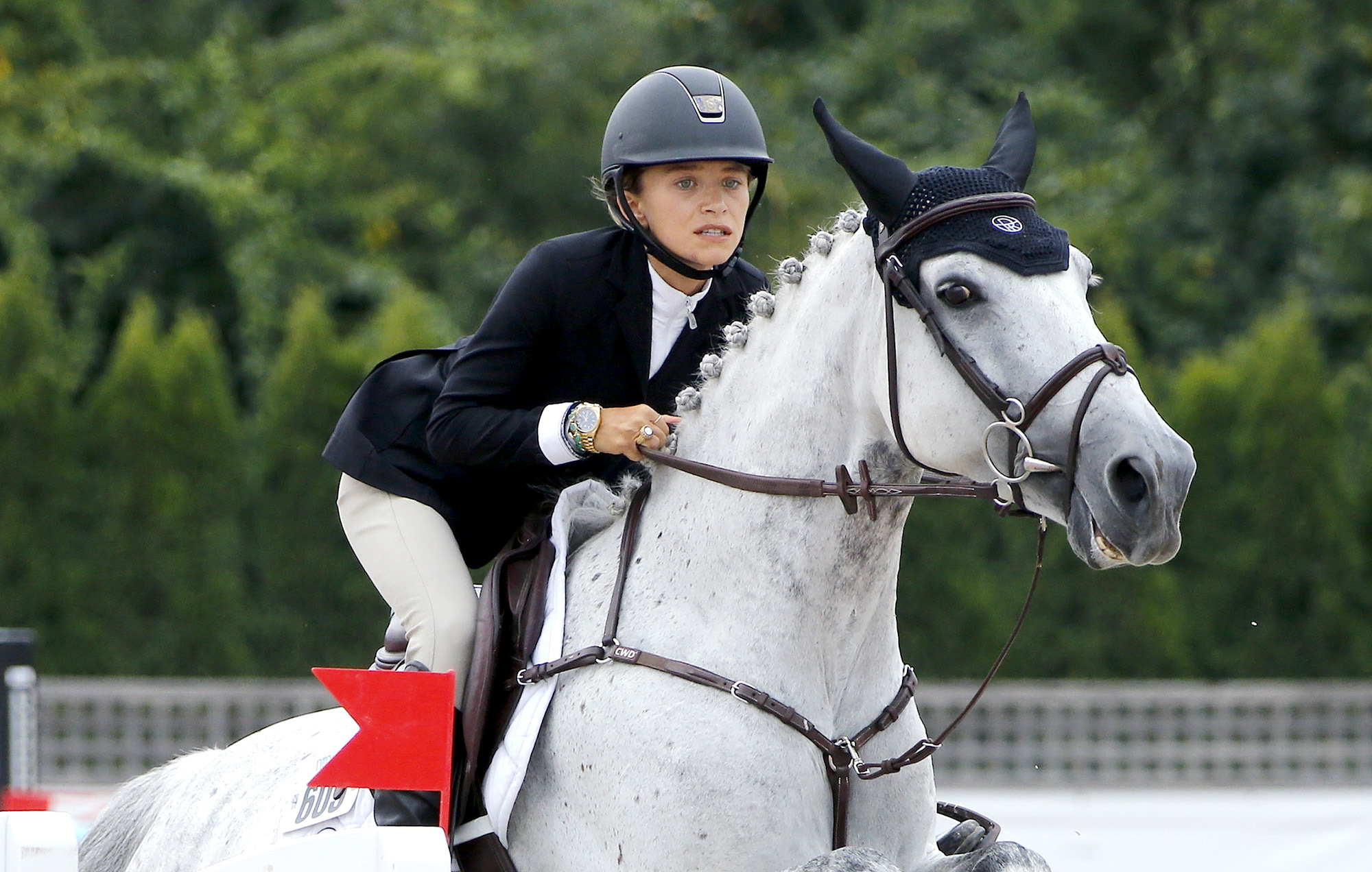 Photo of Mary-Kate Olsen Wears All Her Wedding Jewelry While Competing in Hamptons Horse Show